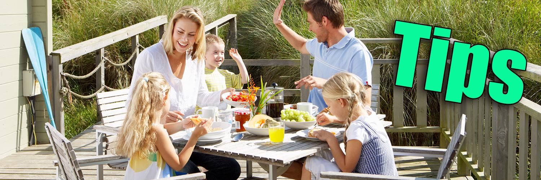 happy family breakfast on bungalow terrace